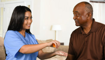 senior's and caregiver's hands