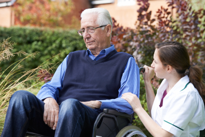 nurse comforting senior man